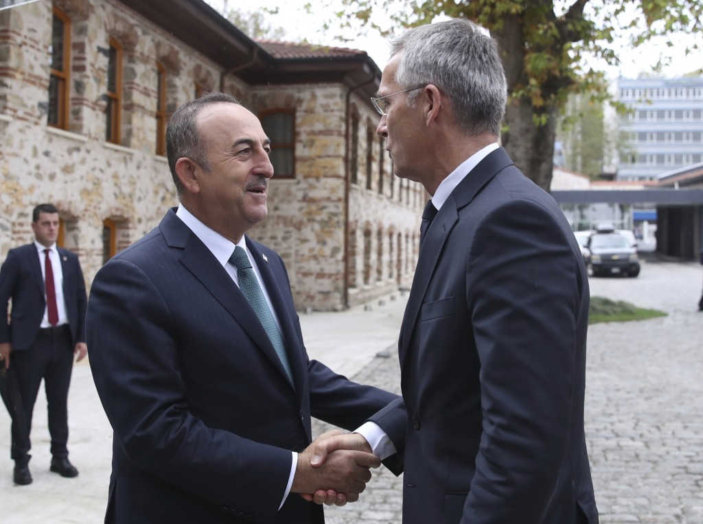 Turkish Foreign Minister Mevlut Cavusoglu, left, welcomes NATO Secretary General Jens Stoltenberg before a meeting in Istanbul, Friday, Oct. 11, 2019....