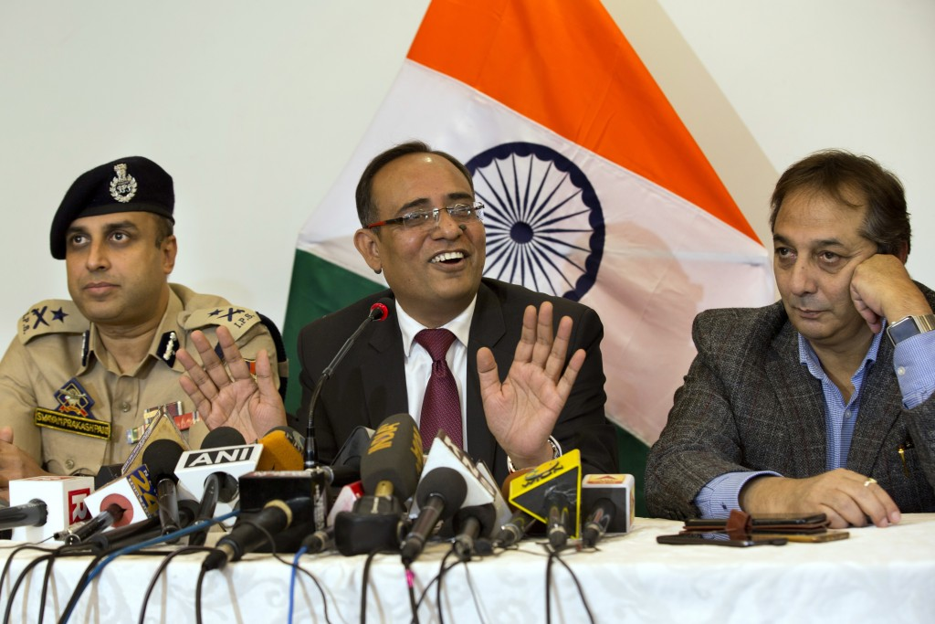 Government spokesperson Rohit Kansal, center, speaks as Swayam Prakash Pani, Inspector General of Police of Kashmir Range, left, and Divisional Commis
