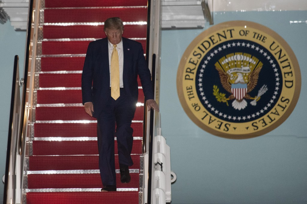 President Donald Trump departs Air Force One early Saturday, Oct. 12, 2019, at Andrews Air Force Base, Md., after returning from a campaign rally in L...