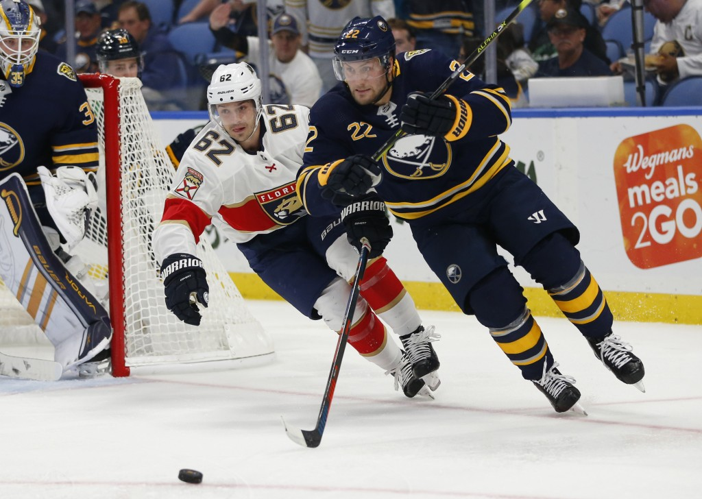 Buffalo Sabres forward Johan Larsson (22) is chased by Florida Panthers forward Denis Malgin (62) during the second period of an NHL hockey game, Frid...