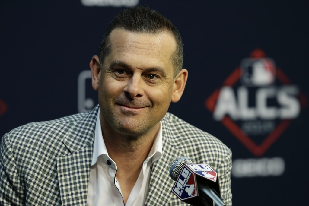New York Yankees manager Aaron Boone talks with the media during a news conference for a baseball American League Championship Series in Houston, Frid