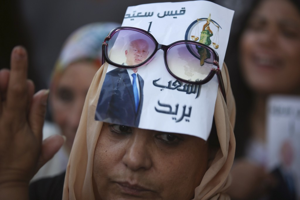 A supporter of independent Tunisian Presidential candidate Kais Saied attends a rally on the last day of campaigning before the second round of the pr...
