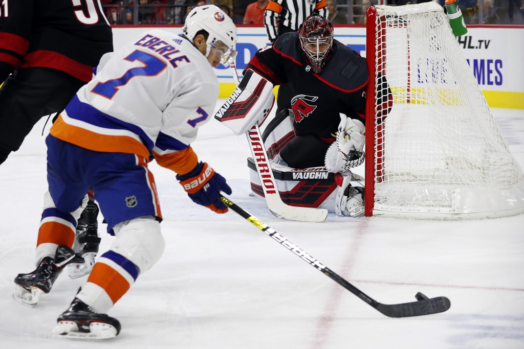 Carolina Hurricanes goaltender Petr Mrazek (34), of the Czech Republic, watches the puck controlled by New York Islanders' Jordan Eberle (7) during th