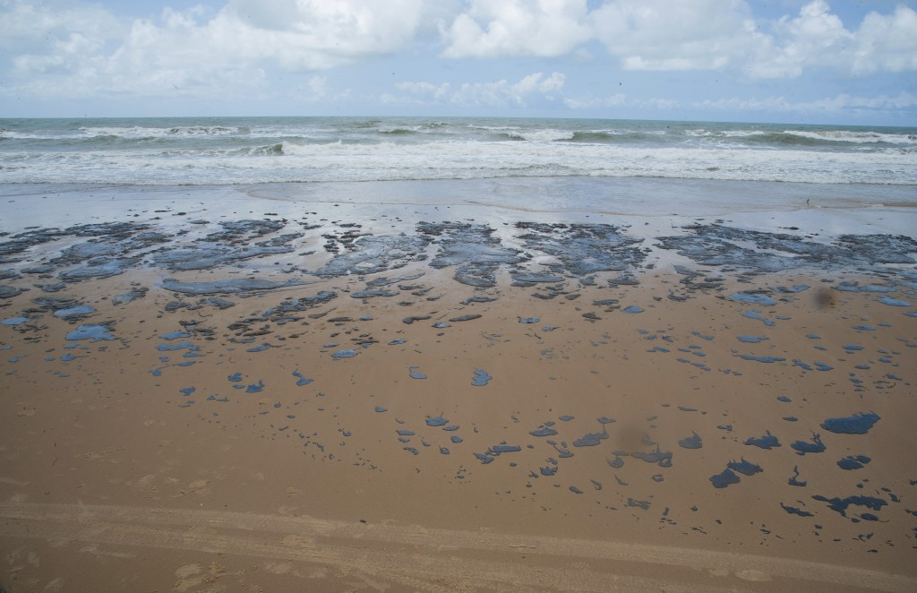 In this Sept. 25, 2019 photo released by the Sergipe state Government, an oil spill covers a beach on Sergipe state, Brazil. The spill started landing