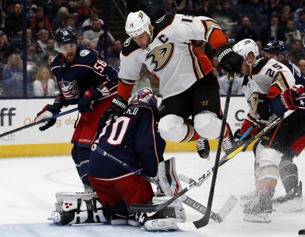 Anaheim Ducks forward Ryan Getzlaf (15) jumps next to Columbus Blue Jackets goalie Joonas Korpisalo (70), of Finland, as Blue Jackets defenseman David...