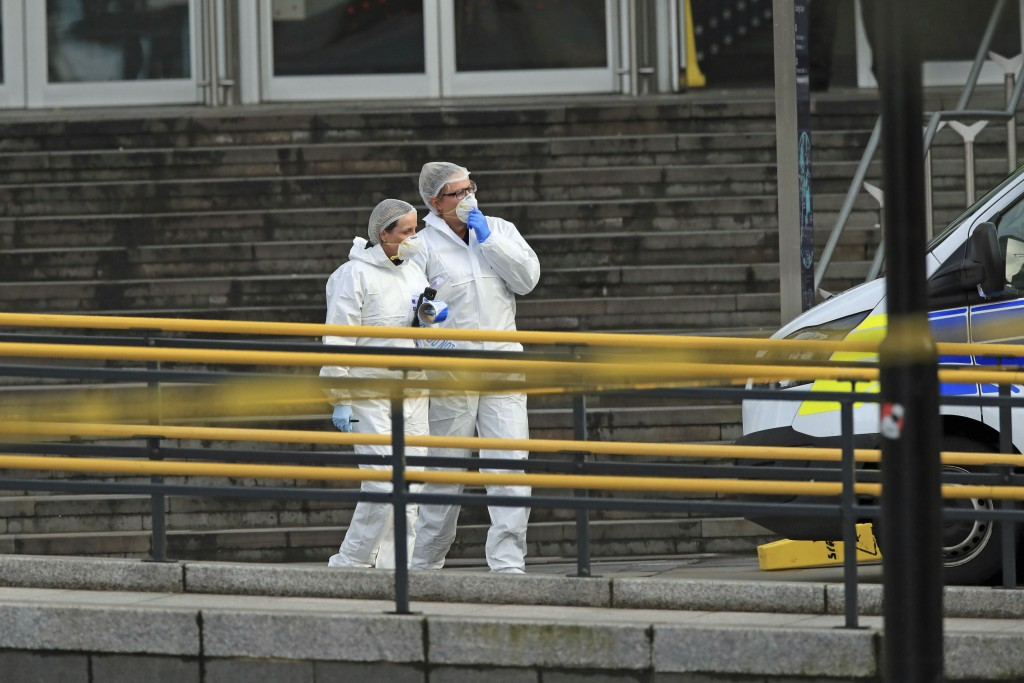 Police forensic officers outside the Arndale Centre in Manchester, England, Friday Oct. 11, 2019, after a stabbing incident at the shopping center tha