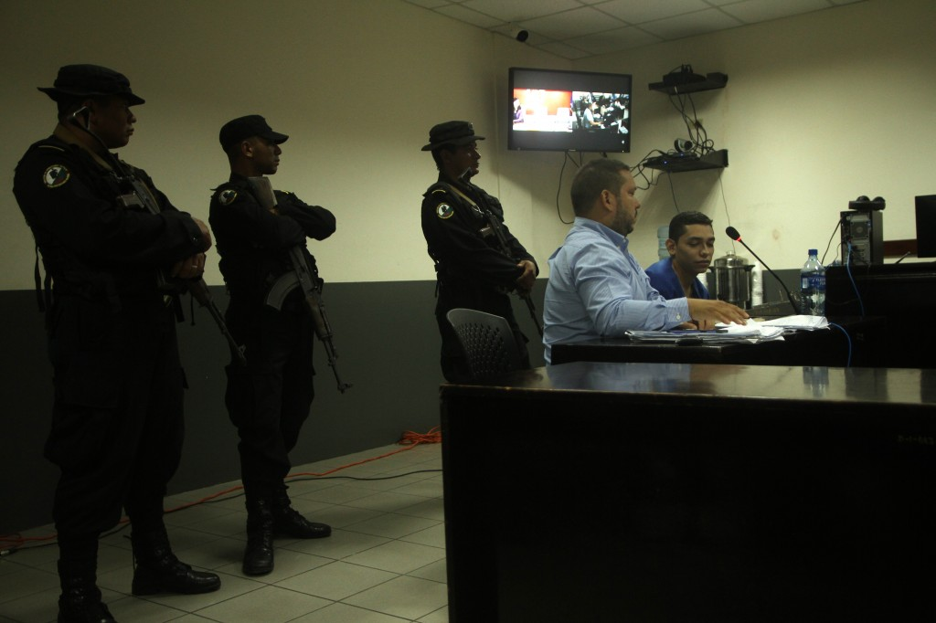 FILE - In this Oct. 11, 2019 file photo, lawyer Eduardo Rubi, center, sitting, appears in court with his client Orlando Tercero  in Managua, Nicaragua...