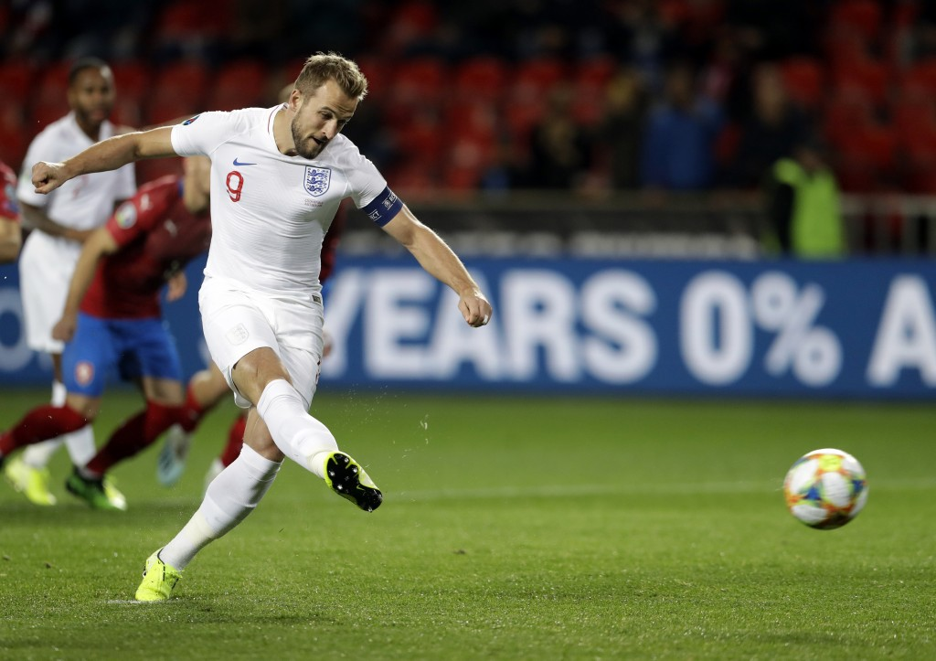 England's Harry Kane scores his side's opening goal from the penalty spot during the Euro 2020 group A qualifying soccer match between Czech Republic ...
