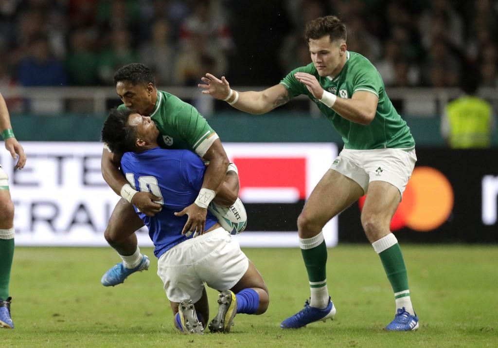 Ireland's Bundee Aki hits Samoa's Ulupano Seuteni in a high tackle during the Rugby World Cup Pool A game at Fukuoka Hakatanomori Stadium between Irel...