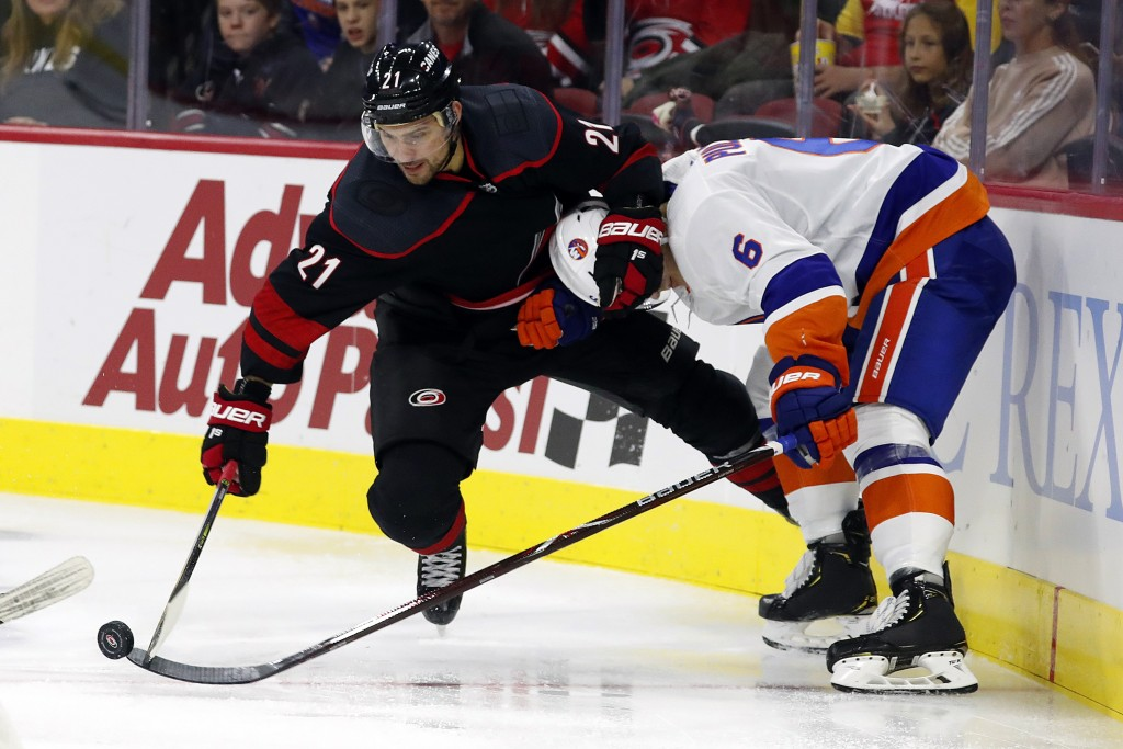 Carolina Hurricanes' Nino Niederreiter (21), of Switzerland, battles with New York Islanders' Ryan Pulock (6) for the puck during the second period of...