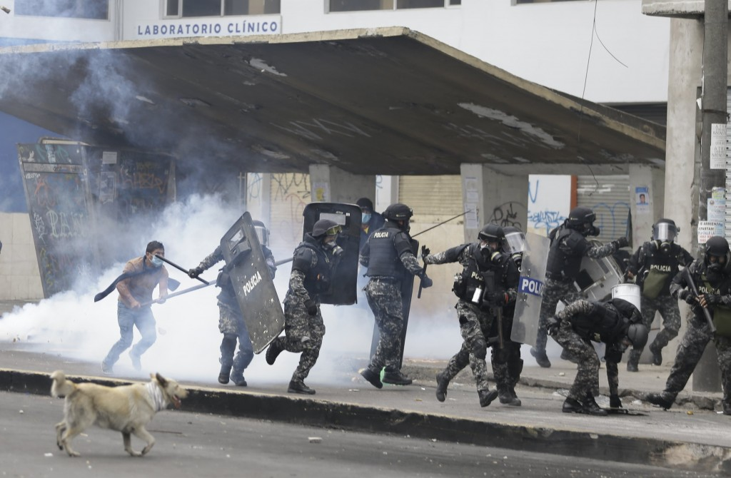 Anti-government demonstrators clash with police in Quito, Ecuador, Friday, Oct. 11, 2019. Protests started last week after Ecuador's President Lenin M...