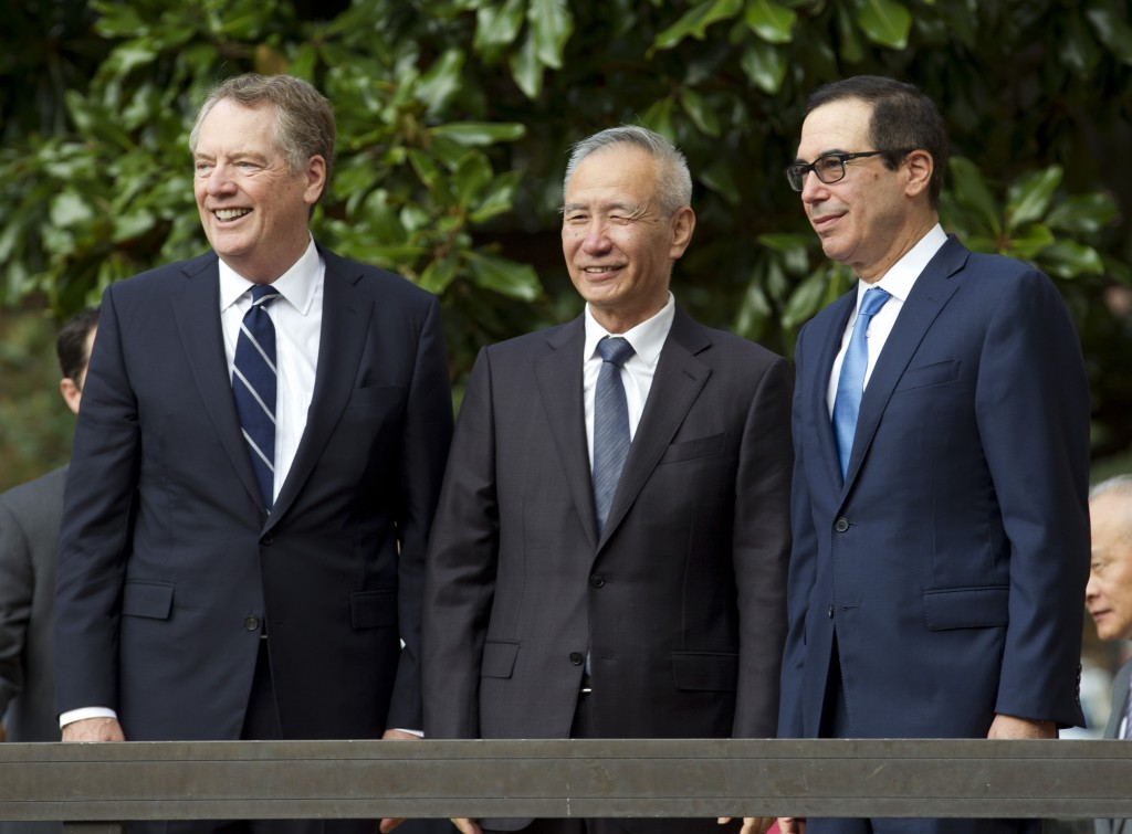 Chinese Vice Premier Liu He accompanied by U.S. Trade Representative Robert Lighthizer, left, and Treasury Secretary Steven Mnuchin, greets the media ...