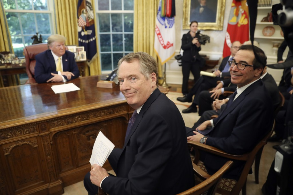 U.S. Trade Representative Robert Lighthizer and Treasury Secretary Steven Mnuchin, right, smile as they attend a meeting with President Donald Trump a...