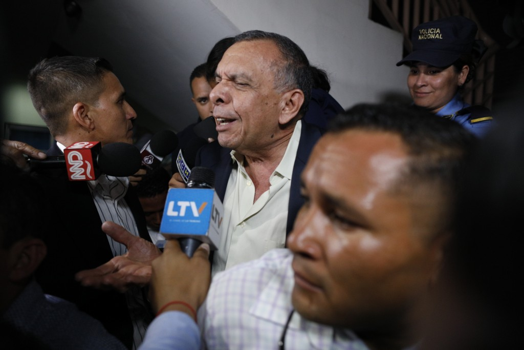 FILE - In this Aug. 20, 2019 file photo, former Honduran President Porfirio Lobo speaks to the press outside court where his wife, former first lady R...
