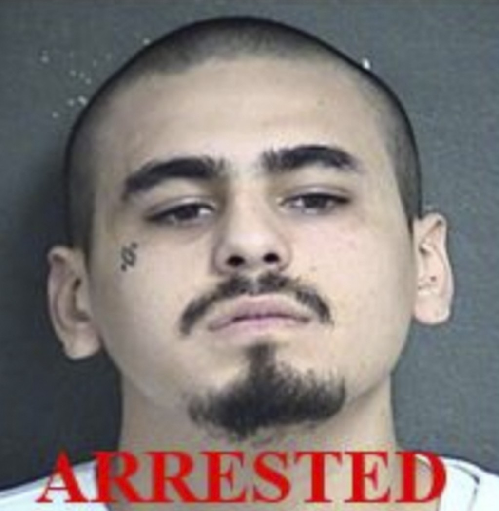 This undated photo provided by the Kansas City Kansas Police Department shows Javier Alatorre. Alatorre, one of the two men accused of opening fire in