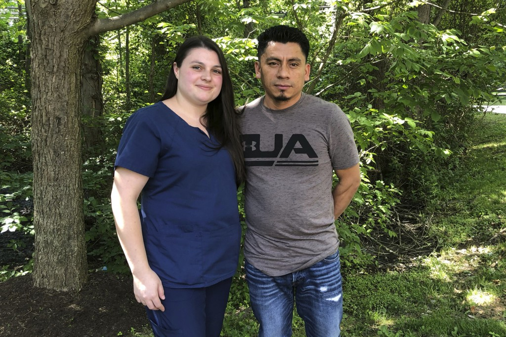 In a photo taken June 21, 2019, Alyse Sanchez and her husband, Elmer Sanchez, pose for The Associated Press in Sandy Spring, Md. The Sanchezes and fiv...