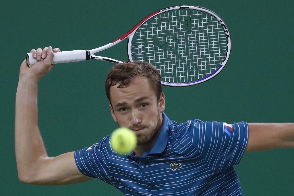 Daniil Medvedev of Russia eyes on the ball as he plays against Stefanos Tsitsipas of Greece in their men's singles semifinals match at the Shanghai Ma