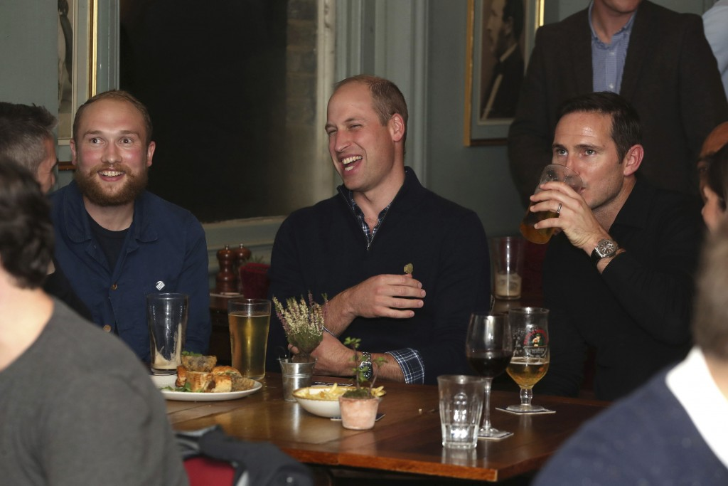 Britain's Prince William, Duke of Cambridge, watches with football fans and Chelsea manager Frank Lampard right, after discussing mental health as par...