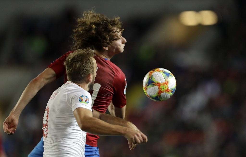 England's Harry Kane, front, jumps for the ball with Czech Republic's Alex Kral during the Euro 2020 group A qualifying soccer match between Czech Rep