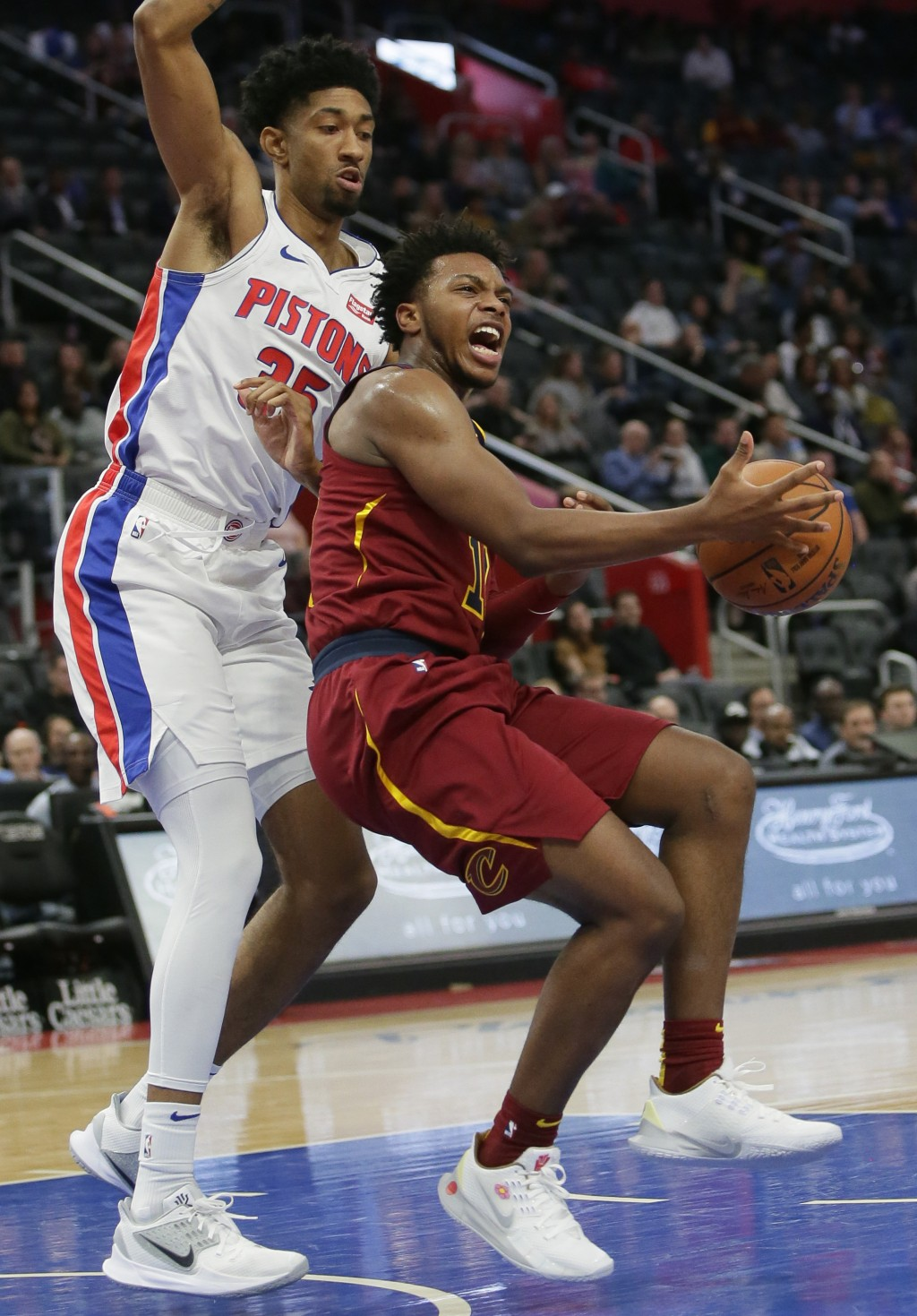 Cleveland Cavaliers guard Darius Garland (10) collides with Detroit Pistons forward Christian Wood (35) while going to the basket during the first hal