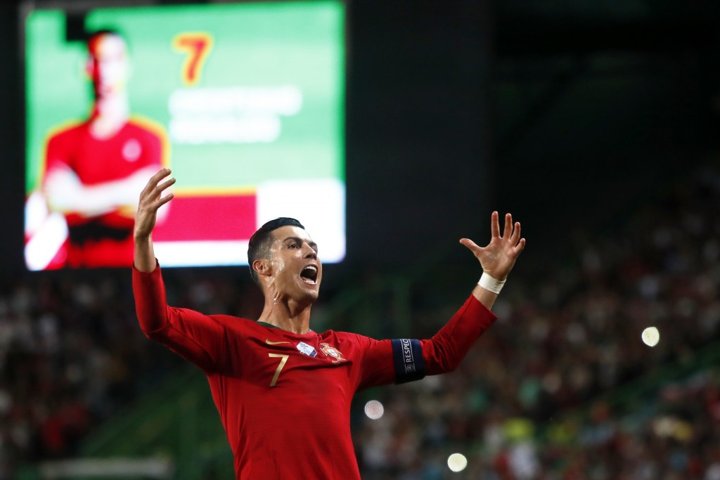 Portugal's Cristiano Ronaldo celebrates after scoring his side's second goal during a Euro 2020 group B qualifying soccer match between Portugal and L