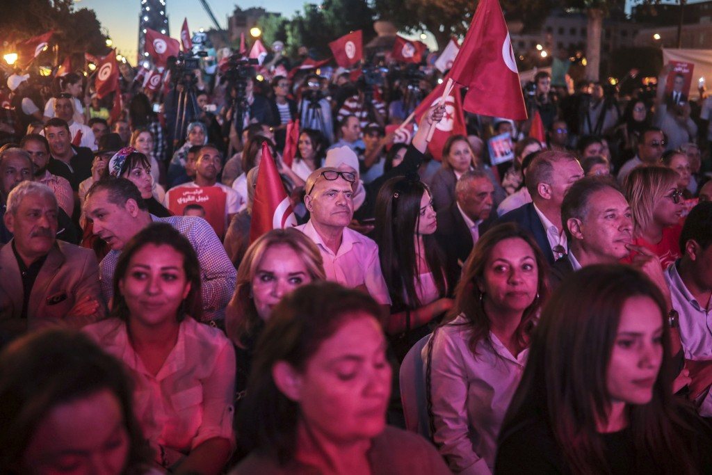 Supporters of Tunisian presidential candidate Nabil Karoui attend a rally on the last day of campaigning before the second round of the presidential e...