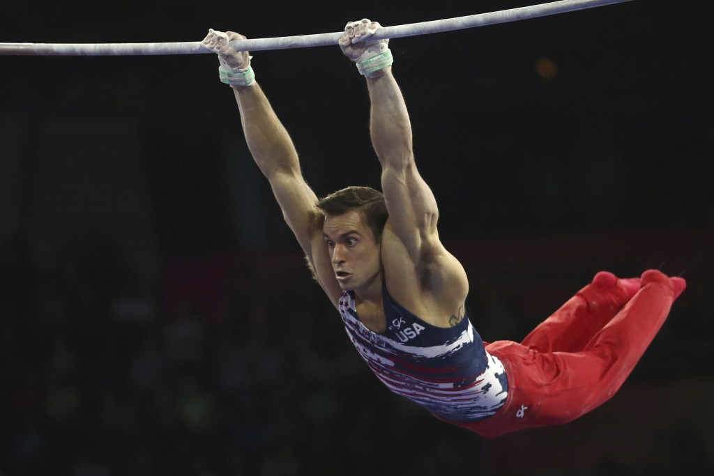 Samuel Mikulak of the United States performs on the horizontal bar in the men's all-around final at the Gymnastics World Championships in Stuttgart, G...