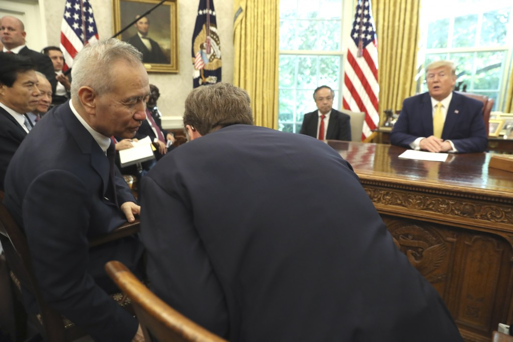 President Donald Trump watches as Chinese Vice Premier Liu He speaks to U.S. Trade representative Robert Lighthizer, right, in the Oval Office of the