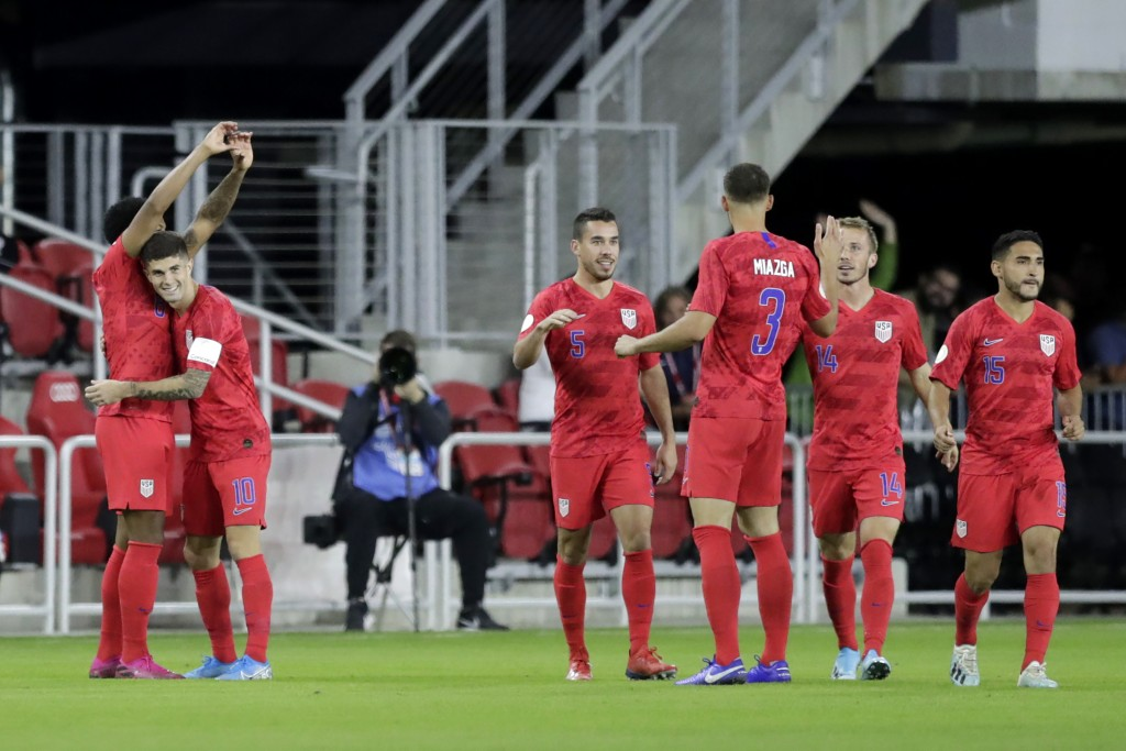 United States' Weston McKennie, left, is congratulated by Christian Pulisic (10) after scoring a goal on Cuba in the first minute of the first half of