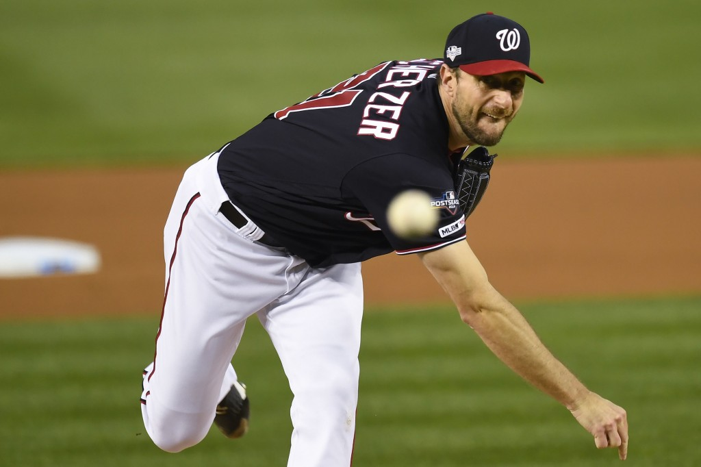Washington Nationals starting pitcher Max Scherzer throws against the Los Angels Dodgers during the first inning in Game 4 of a baseball National Leag...