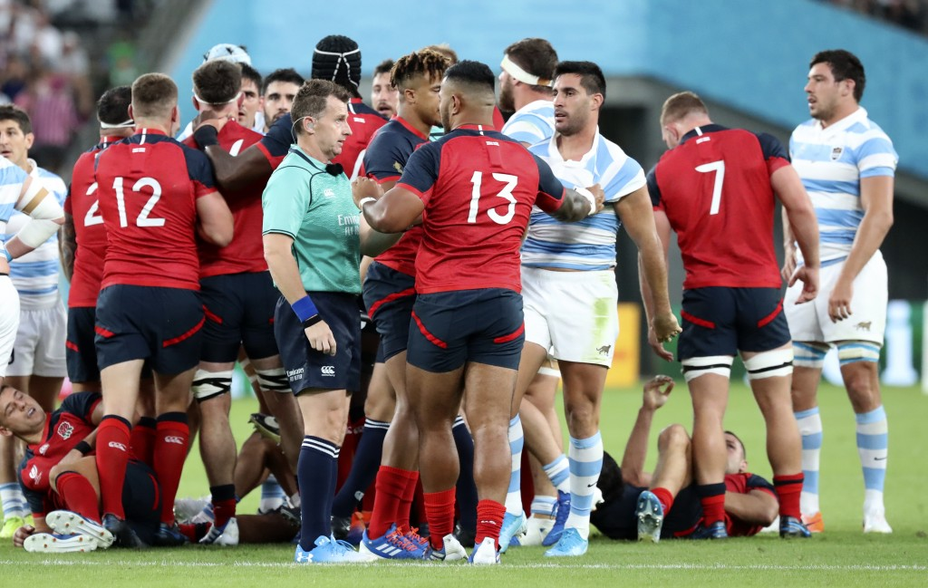 Referee Nigel Owens talks to England's Manu Tuilagi after a player scuffle during the Rugby World Cup Pool C game at Tokyo Stadium between England and