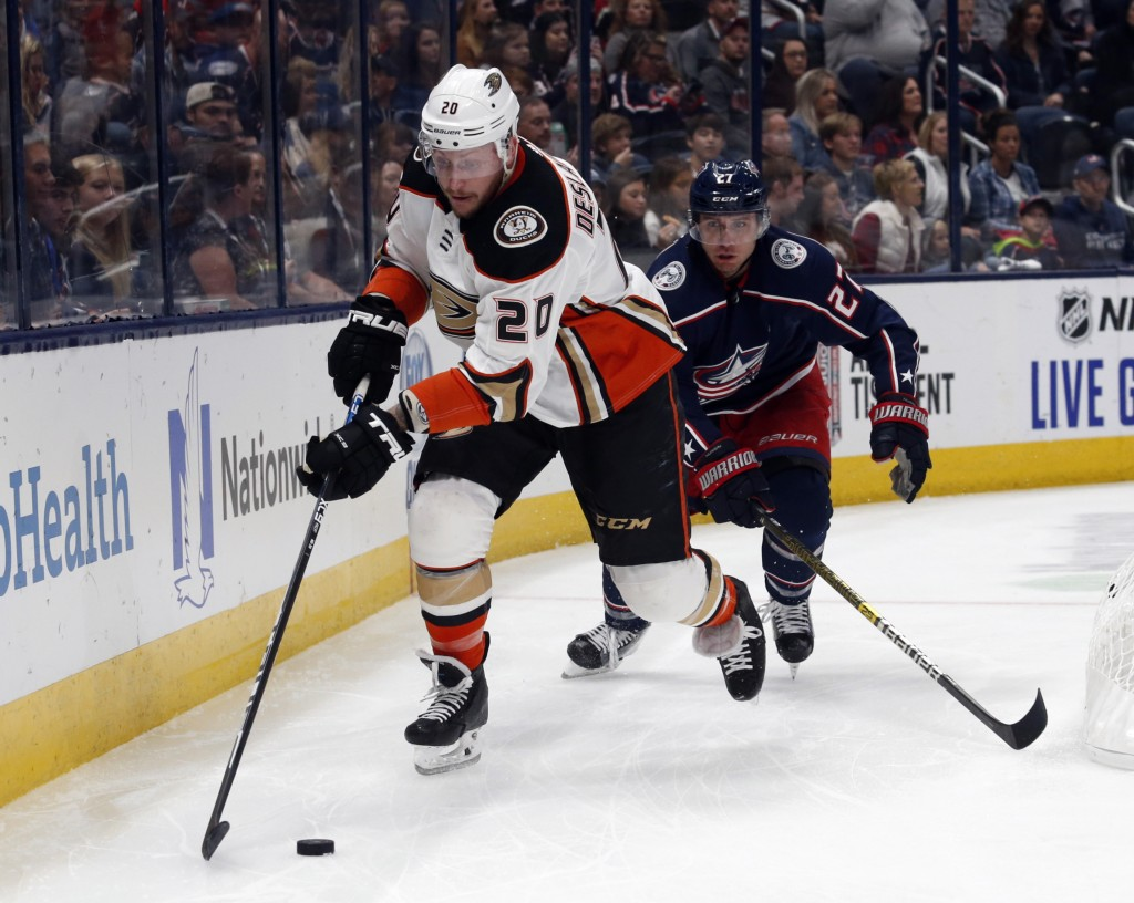 Anaheim Ducks forward Nicolas Deslauriers, left, controls the puck in front of Columbus Blue Jackets defenseman Ryan Murray during the first period of