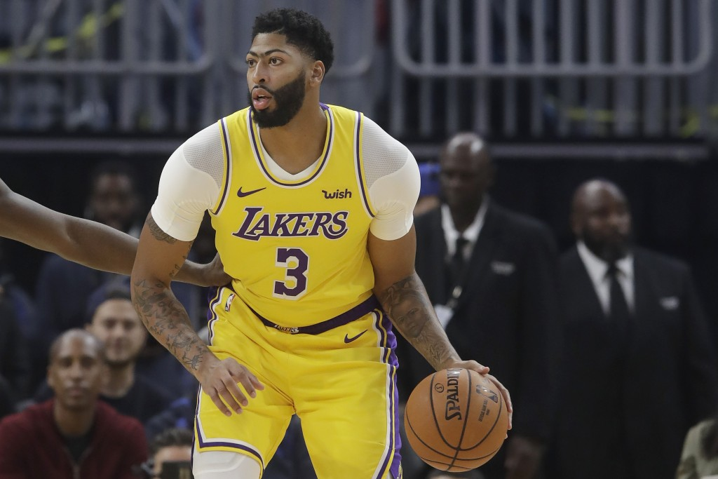Los Angeles Lakers forward Anthony Davis dribbles during the first half of the team's preseason NBA basketball game against the Golden State Warriors ...