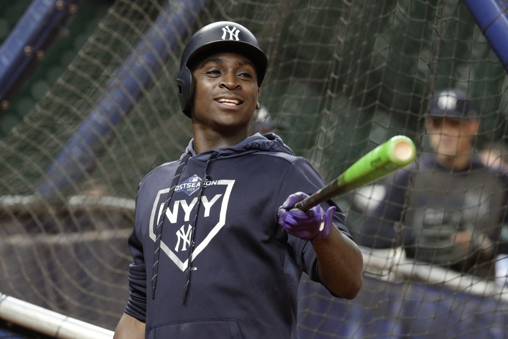 New York Yankees shortstop Didi Gregorius jokes with teammates during batting practice for a baseball American League Championship Series in Houston,