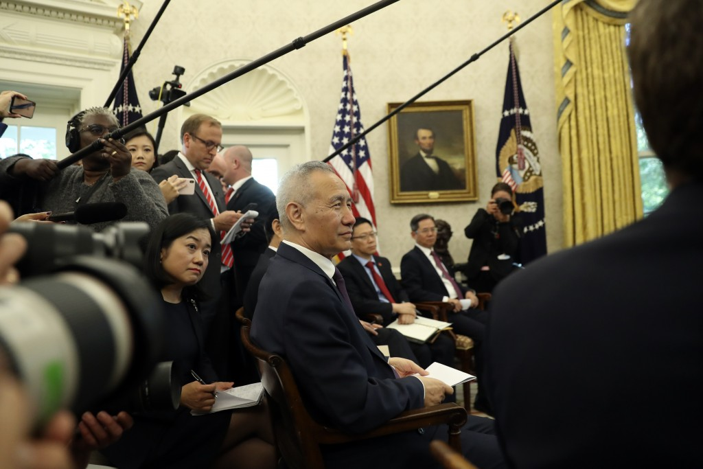 Chinese Vice Premier Liu He listens as he meets with President Donald Trump in the Oval Office of the White House in Washington, Friday, Oct. 11, 2019...
