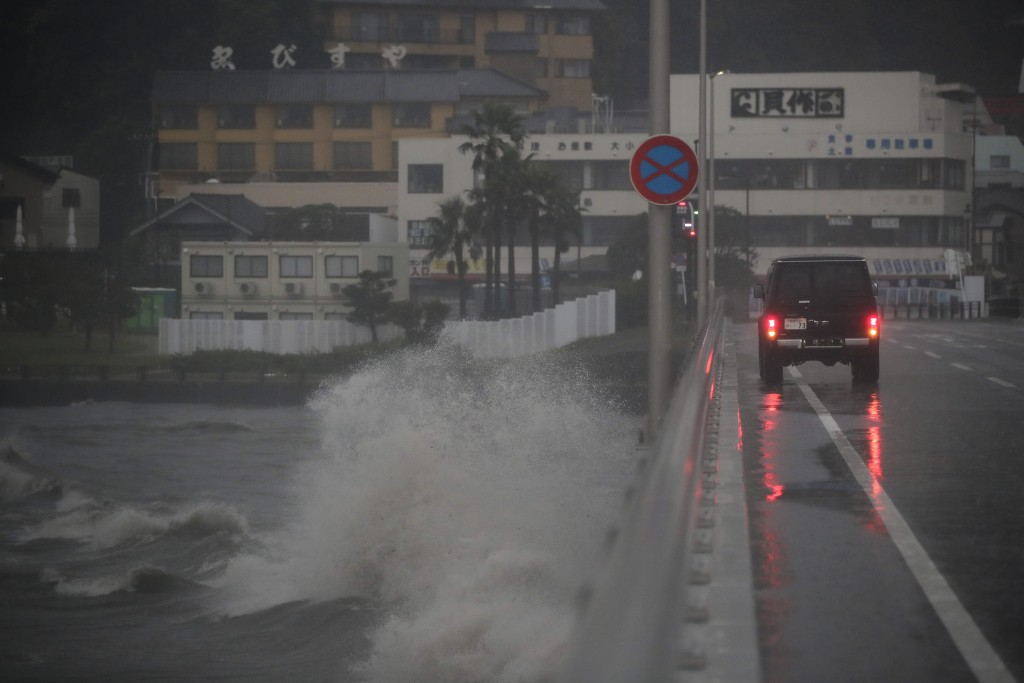 Waves crash against a bridge connecting to Enoshima Island, Saturday, Oct. 12, 2019, in Fujisawa, Japan, west of Tokyo. A powerful typhoon is forecast...