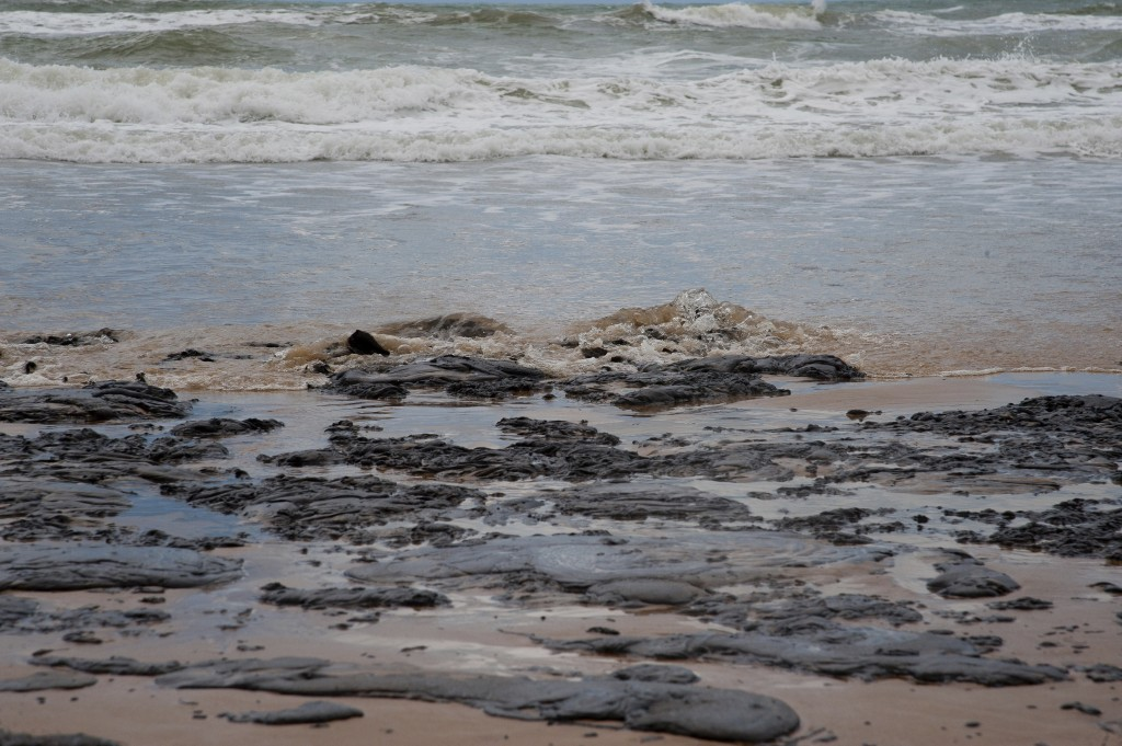 In this Sept. 25, 2019 photo released by the Sergipe state Government, an oil spill covers a beach on Sergipe state, Brazil. The spill started landing...