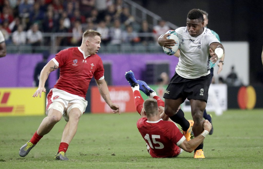 Fiji's Josua Tuisova is tackled by Wales' Liam Williams during the Rugby World Cup Pool D game at Oita Stadium between Wales and Fiji in Oita, Japan,