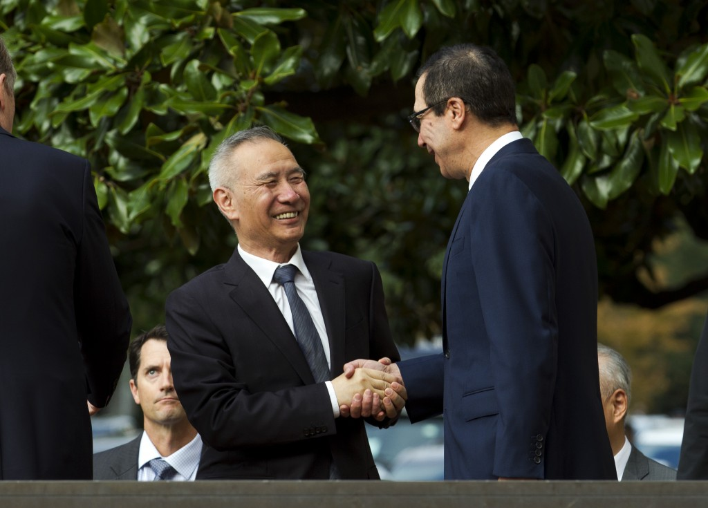 Chinese Vice Premier Liu He shake hands with Treasury Secretary Steven Mnuchin, as he arrives for a minister-level trade meeting in Washington, Thursd...