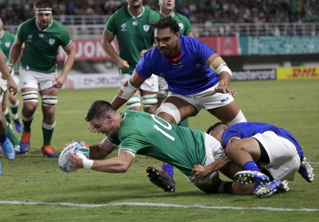 Ireland's Johnny Sexton reaches out to score a try during the Rugby World Cup Pool A game at Fukuoka Hakatanomori Stadium between Ireland and Samoa, i...