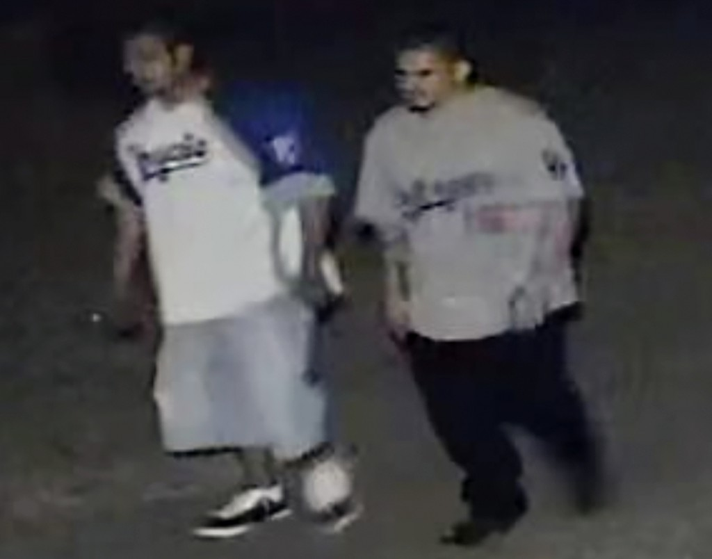 This frame grab from surveillance video provided by the Kansas City, Kan. Police Department shows two suspects authorities are looking for in connecti