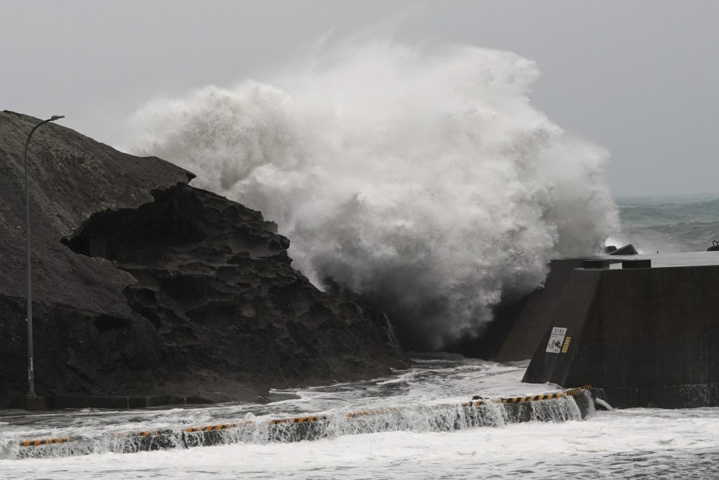 Surging waves hitting against the breakwater as Typhoon Hagibis approaches at a port in Kumano, Mie Prefecture, Japan Saturday, Oct. 12, 2019. (AP Pho...