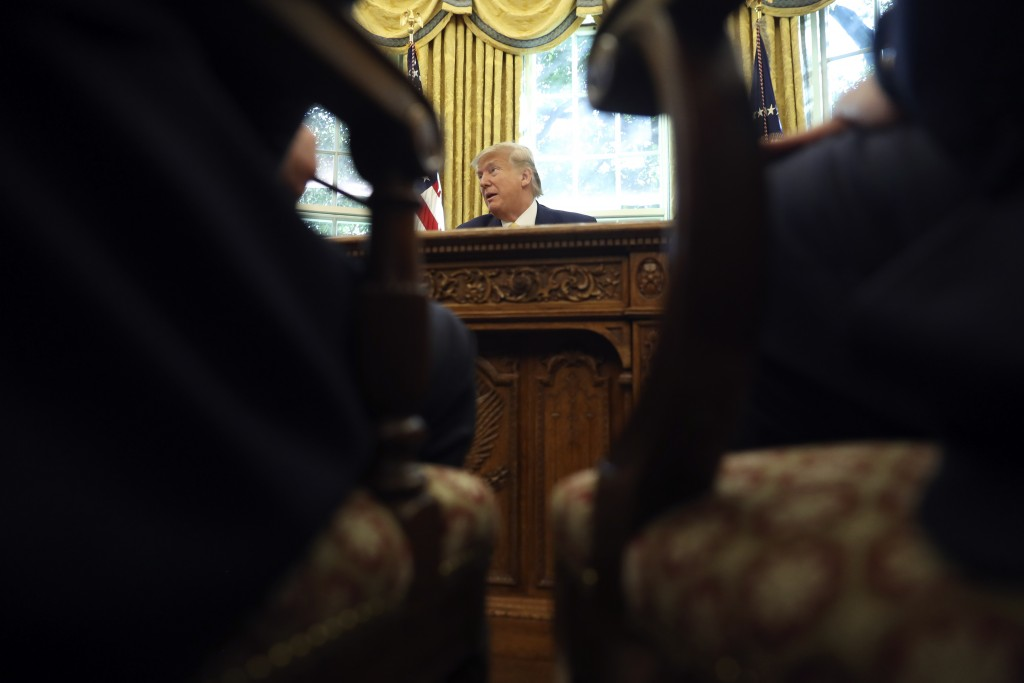 President Donald Trump listens as he meets with Chinese Vice Premier Liu He in the Oval Office of the White House in Washington, Friday, Oct. 11, 2019...