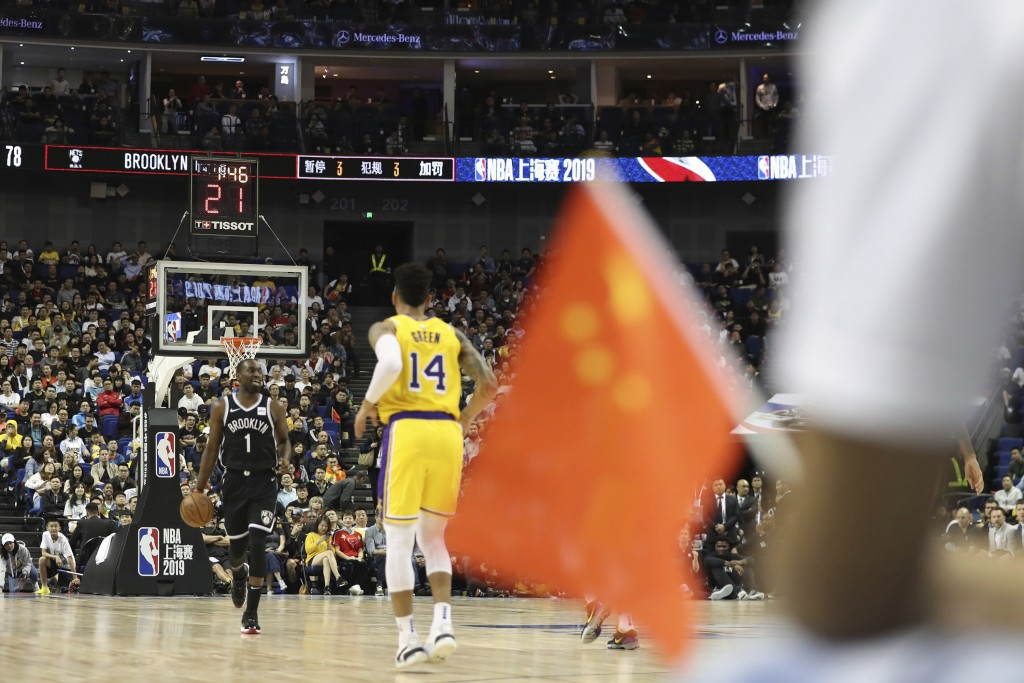 In this Thursday, Oct. 10, 2019, photo, Brooklyn Nets' Theo Pinson, left, drives against Los Angeles Lakers' Danny Green, right, near a Chinese nation