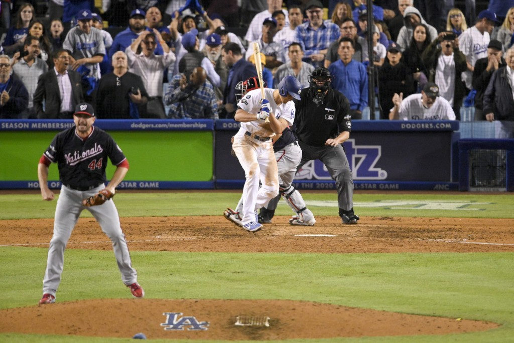 Washington Nationals relief pitcher Daniel Hudson, left, celebrates after Los Angeles Dodgers' Corey Seager struck out to end Game 2 of a baseball Nat