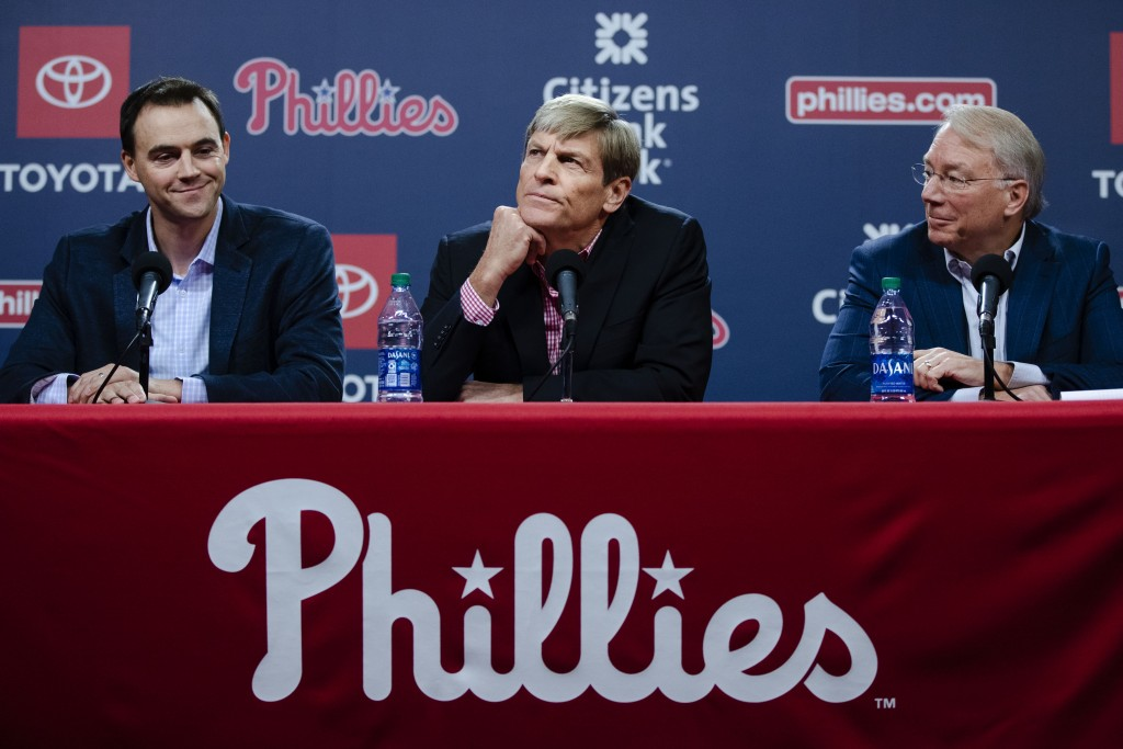Philadelphia Phillies general manager Matt Klentak, left, managing partner John Middleton and president Andy MacPhail, right, hold a news conference i...