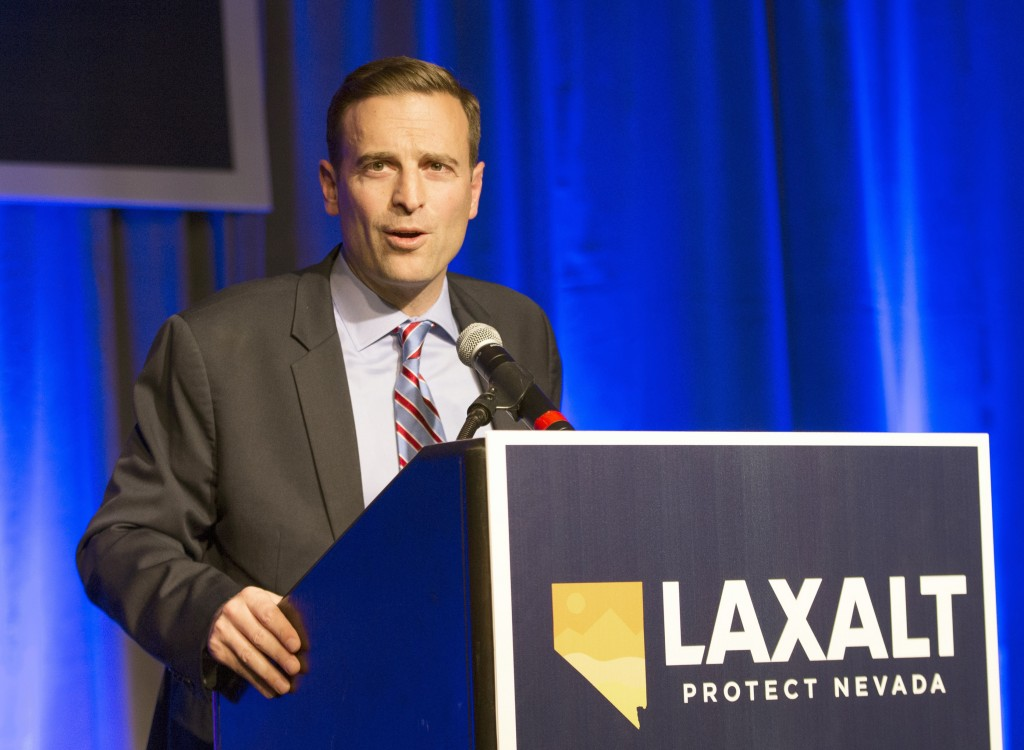FILE - In this Nov. 6, 2018 file photo Republican Adam Laxalt concedes the Nevada governor's race to Democrat Steve Sisolak in Reno, Nev. Sisolak is e