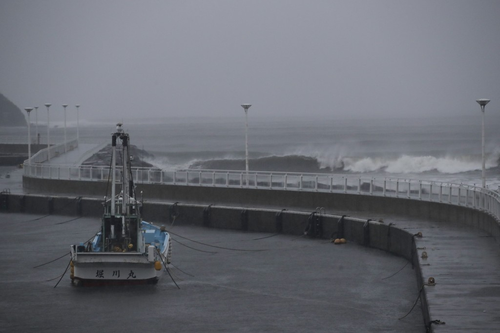 A boat is anchored as Typhoon Hagibis approaches Saturday, Oct. 12, 2019 in Fujisawa, Japan, west of Tokyo. The powerful typhoon is forecast to bring ...