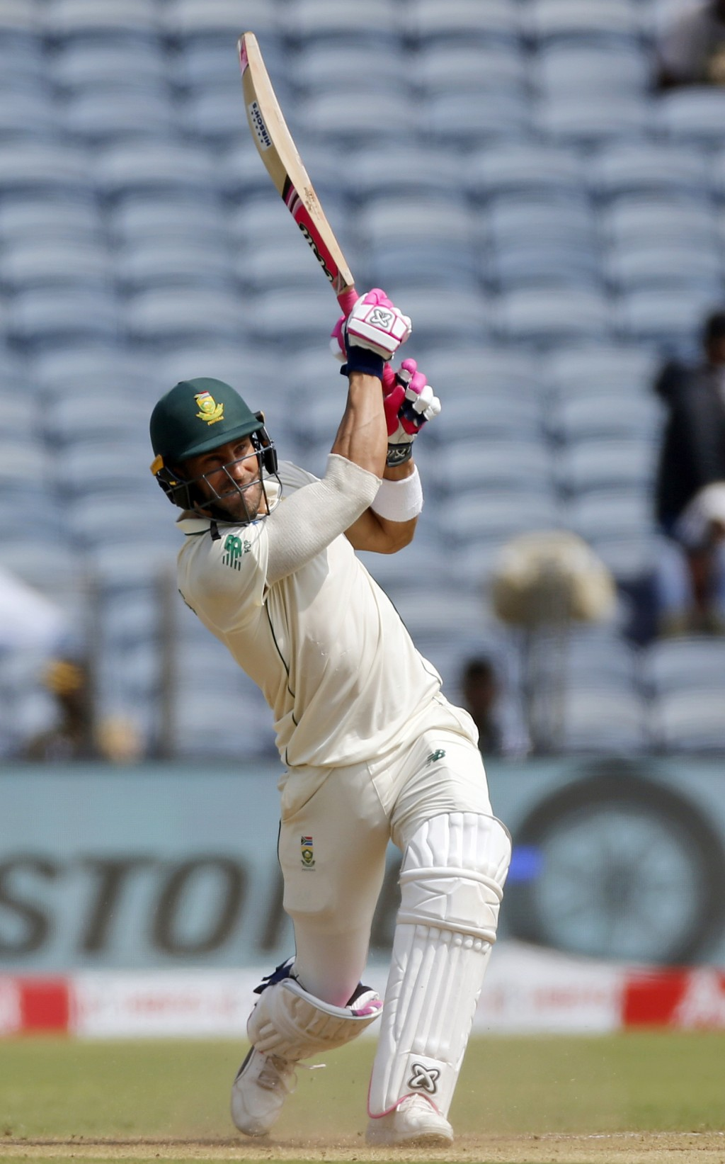 South African cricketer Faf du Plessis bats during the third day of the second cricket test match between India and South Africa in Pune, India, Satur