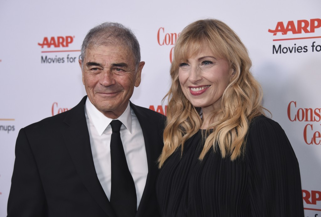 FILE - In this Jan. 4, 2019 file photo, Robert Forster, left, and Denise Grayson attend the 18th Annual Movies For Grownups Awards at Beverly Wilshire